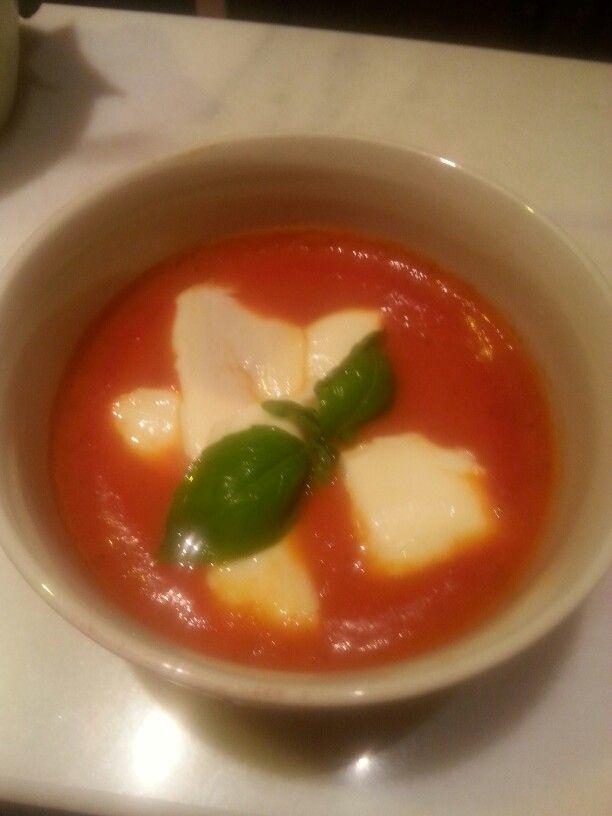 Fresh tomato soup with mozzarella and basil