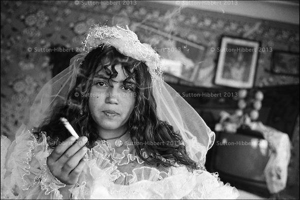 Sofia Mihai, aged 12, has been married twice and divorced twice has now returned home to live with her parents in the Kalderash Roma camp of Sintesti, near Bucharest. It is normal for the girls of the camp to marry when they are in their early teenage years.