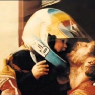 Valentino Rossi with his father Graziano....eerie..... dad's profile looks like Simonceli's......