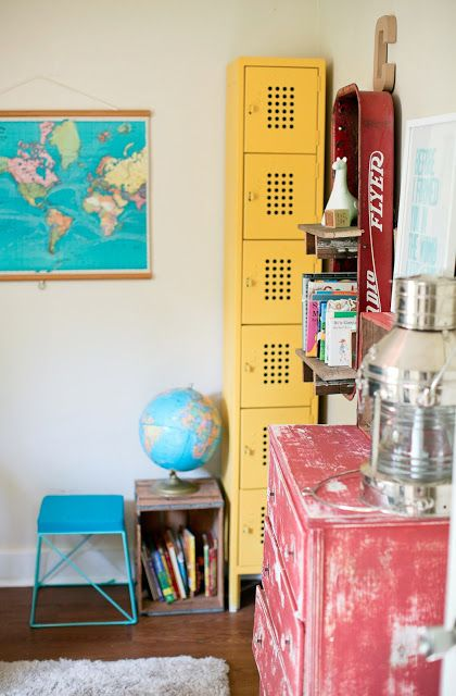Caden's colorful room with pull-down map, globe, yellow lockers and DIY touches