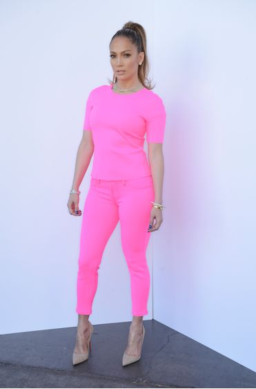 J Lo in a hot pink outfit comprised of a searing $195 J Brand Neoprene top and $185 Wildflower Jeans by the brand and Loubs!
