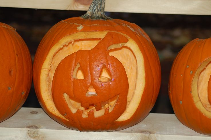 This jack-o'-lantern *within* a pumpkin is a great change of pace from the standard jack-o'-lantern. It just goes to show that your pumpkin decorating possibilities are limited only by your imagination. Get more inspiration in my Pumpkin Faces picture gallery: http://landscaping.about.com/od/galleryoflandscapephotos/ig/pumpkin-faces/