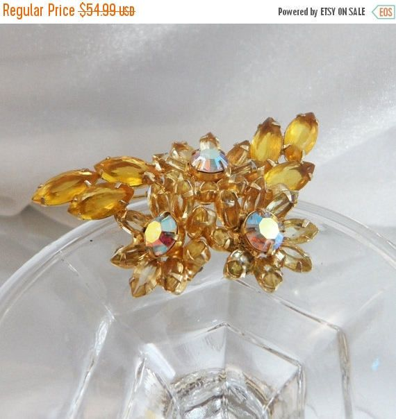 This #vintage Juliana brooch just takes your breath away.  It features sparkling yellow marquise shaped rhinestones with open backs in a gold plated setting around the edges... #ecochic #etsy #jewelry #jewellery