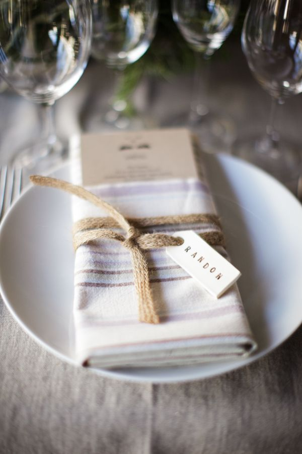 Modern guest ceramic nametags, tied to napkins. Photo: Sasha Gulish. Event Planner: Shannon Leahy Events