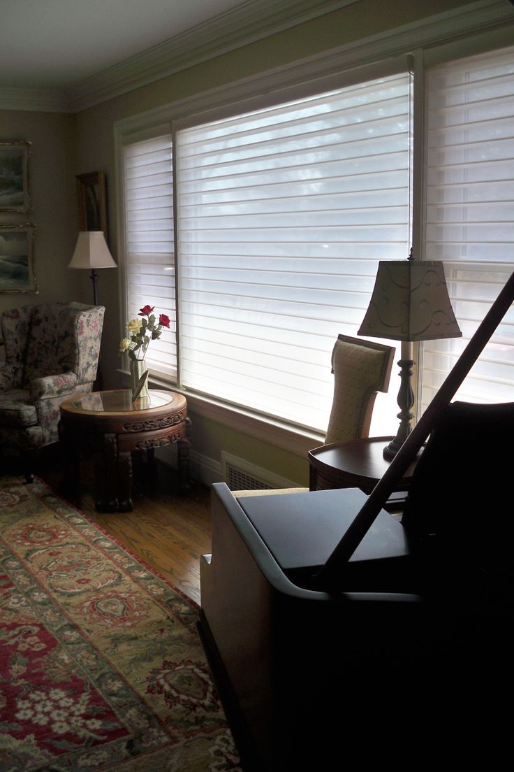 colourful traditional home with #Hunter Douglas Silhouette window shades on large window