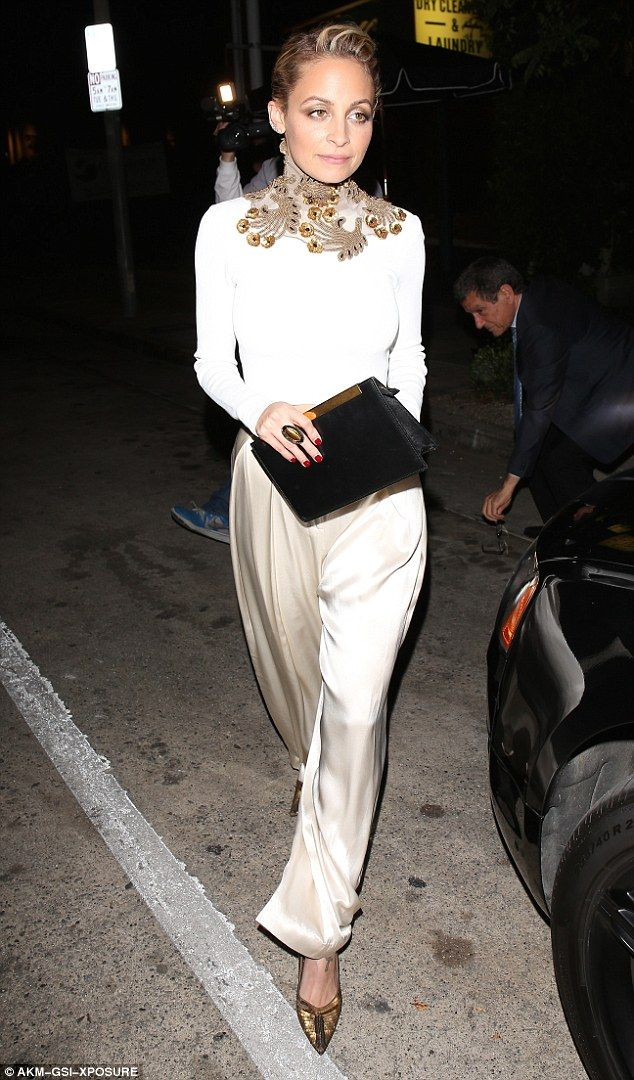 Staying true to form: Nicole Richie put on a sartorially stunning display as she attended Kate Hudson's book launch in West Hollywood, California, on Tuesday evening