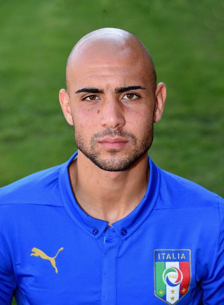 Simone Zaza Photos Photos - Simone Zaza of Italy poses during the official portrait session at Coverciano on August 31, 2015 in Florence, Italy. - Italy Training Session And Press Conference