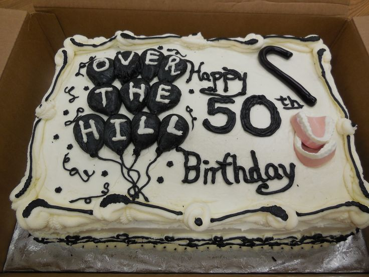 Over the hill 50th birthday cake with false teeth cane for 50th birthday cake decoration ideas