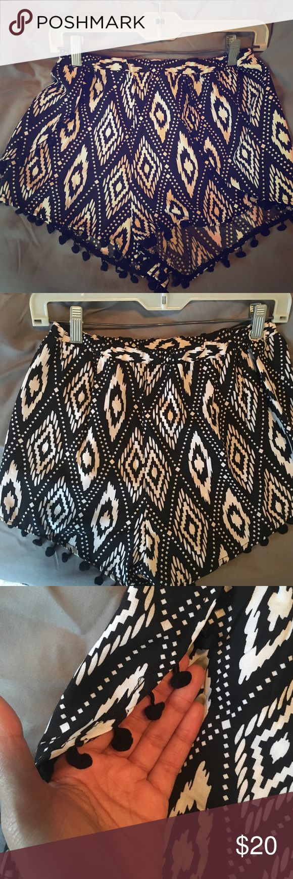 Black and white boho tribal shorts size M Super cute & trendy tribal shorts were purchased last summer & were never ever worn. No signs of damage or wear & tear 😊 As pictured there are little black pompoms along the bottom and on flaps of the shorts! Perfect for the warmer weather we'll have in a few months 🌞 Go Jane Shorts