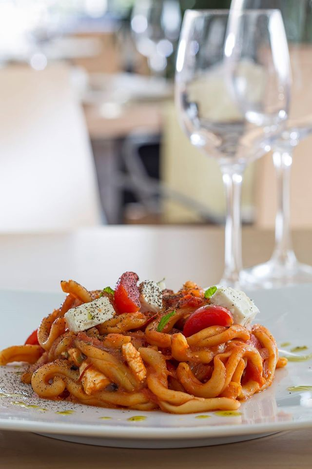 """Try our traditional Cretan pasta named """"skioufixta"""" made with local cheese, tomatoe sauce and herbs."""