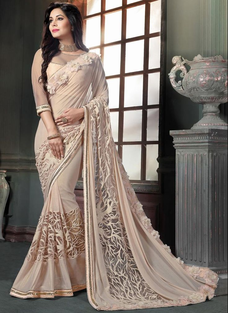 Online shopping store for women clothing like designer sarees. Shop this stylish georgette cream designer traditional sarees.