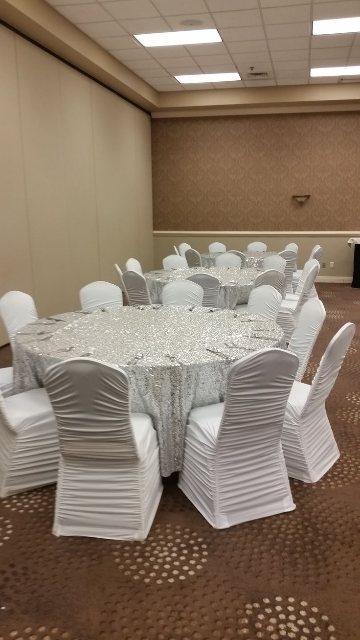 Columns ivory fabric uplighting wedding ceremony downtown double tree - Gorgeous Table Set Up At The Doubletree Hotel With Silver Sequin Tablecloths And White Rouged Chair