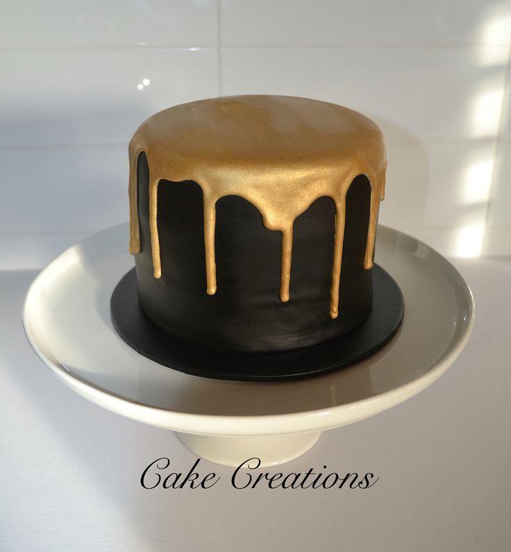 Black fondant and gold Royal icing drip.