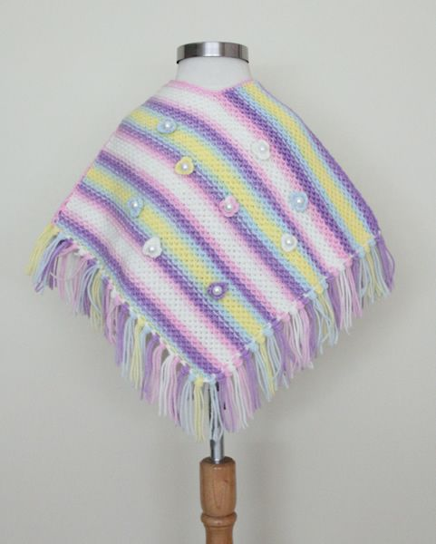 http://www.woollyandwarmy.com/collections/baby-pancho/products/baby-pancho-550-10