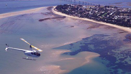 A helicopter touring Phillip Island, Victoria, Australia