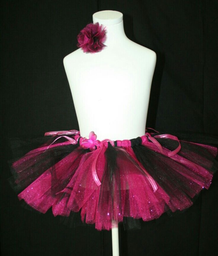 Hot pink and black tutu skirt, with tulle flower hair clip. Butterfly and ribbon detail on skirt.