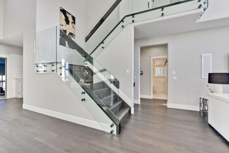 Glass railings keep the space open feeling! So modern and chic!