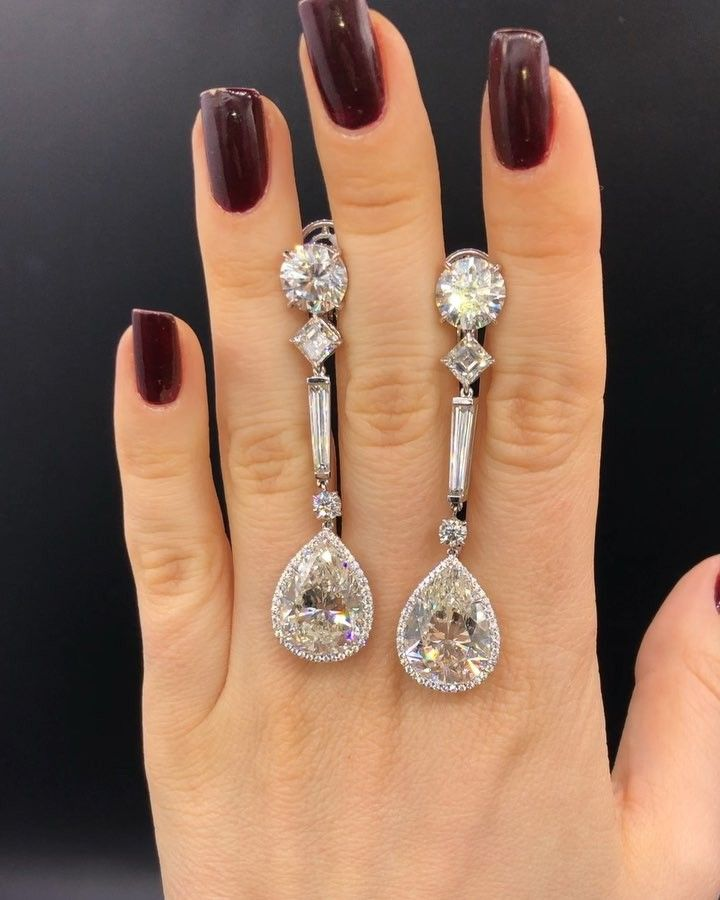 Diana M. Jewels (@dianamjewels) on Instagram: Magnicefent spectacular pear drops down earrings set with GIA certified 19.58 cts pear diamonds with microwave diamonds all the way around and diamond on the side 10.9 cts in platinum setting #dianamjewels #gold #diamond #platinum #ring #earrings