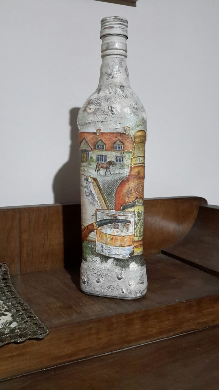 An old bottle whisky   with decoupage