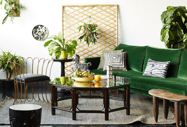 The emerald velvet upholstery, swoop arms, and slender, tapered legs make this sofa an undeniably glamorous piece. The cushion fill of high-density foam wrapped in Dacron and feathers ensures...