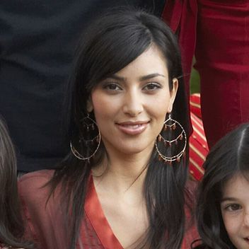 Kim Kardashian - I think she is so much prettier with less makeup :) looks so young here