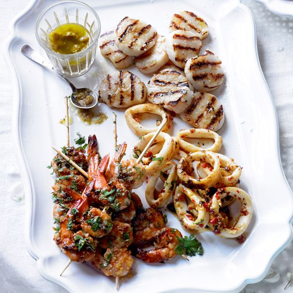 This simple barbecued seafood recipe with prawns, squid and scallops makes a beautifully indulgent starter.
