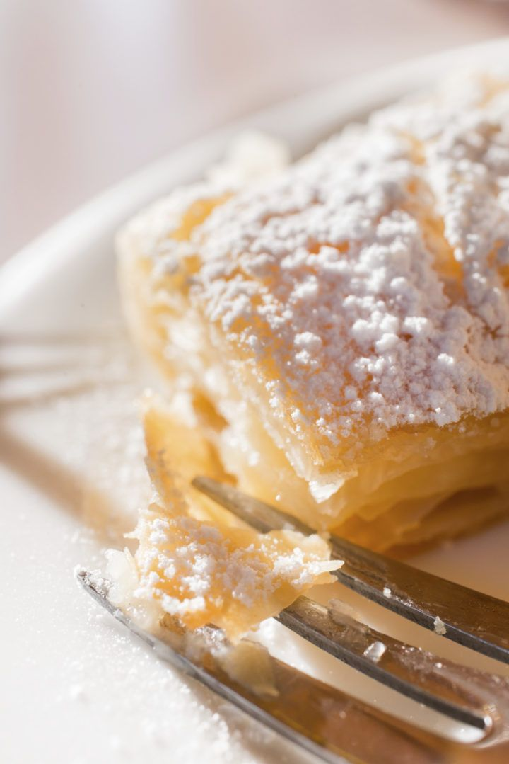 Macro closeup of traditional greek bougatsa, covered in powdered sugar.