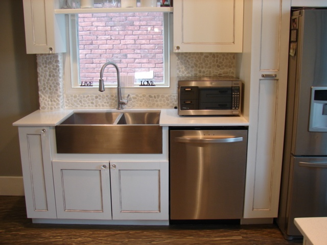 with stainless steal appliances and sink love the pebble backsplash