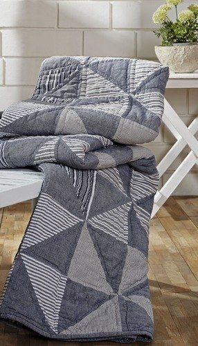 Our Huron Quilted Throw – Primitive Star Quilt Shop is a pretty muted blue grey color in a pinwheel design. It will be sure to keep you warm on chilly nights. Curl up with a warm beverage and a good book for a cozy activity. https://www.primitivestarquiltshop.com/products/huron-quilted-throw #primitivequiltedthrows