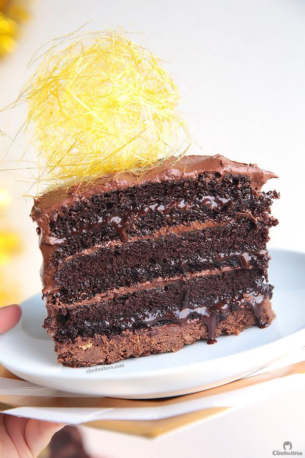 Hands down the ULTIMATE Nutella Cake! With more than 3 1/2 cups of Nutella between the frosting, sauce-y filling and crunchy bottom, this impossibly moist layer cake is a Nutella lover's dream come true! {Video of the making included!}