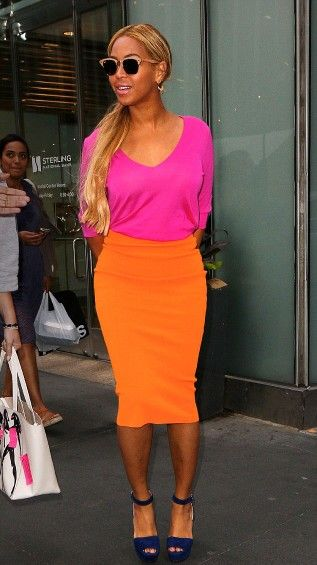 Beyoncé in a pink top combined with an orange skirt and navy platform heels loving the colors!!