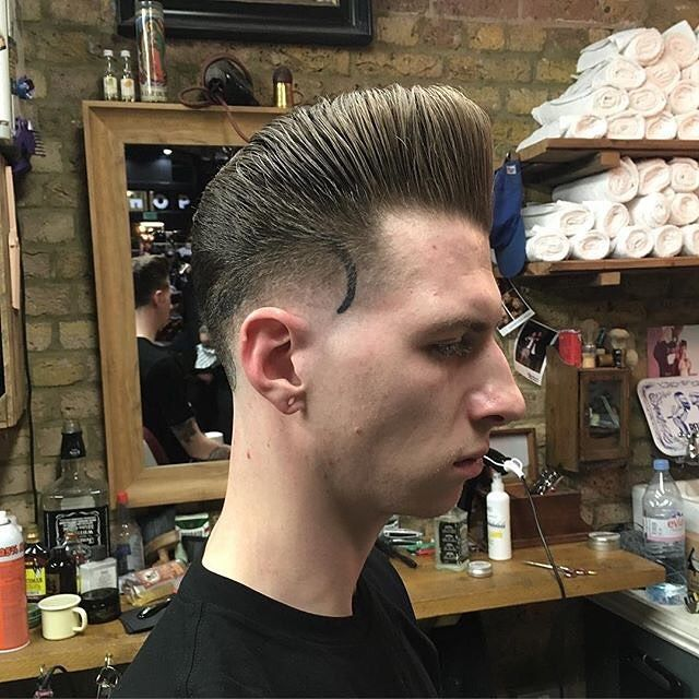 Post by @paulyharmer Low skin fade pompadour finished with @theholyblack pomade  #thybarber #thybarberlondon #london #eastlondon #hackney #barber #barberlife #pompadour #thebikeshed #shoreditch #theholyblack #traditionalbarber