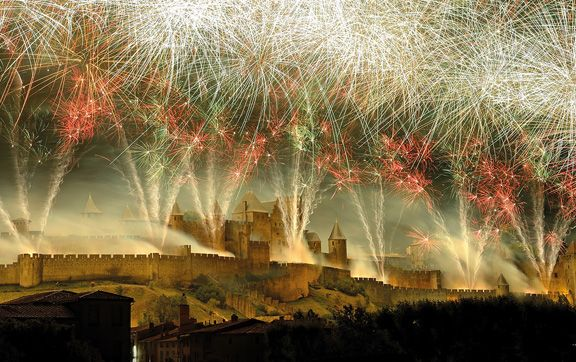 Cruise along France's canals on a luxury barge and explore the French festival season. #francecanal #luxurybarge #frenchfestivals #fireworks #castles