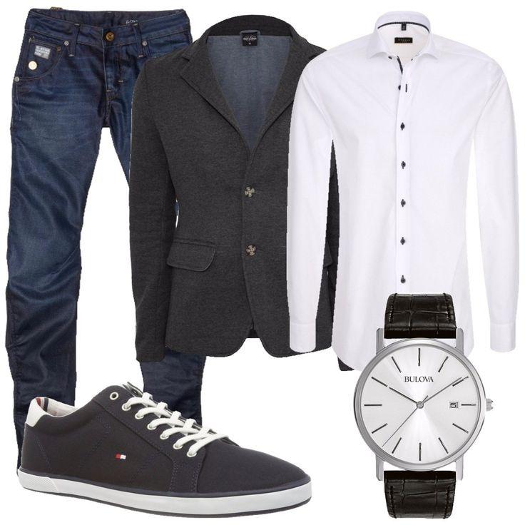 Total look composto da: camicia bianca slim fit a maniche lunghe, blazer grigio scuro, jeans blue del brand G-Star, sneakers basse blu con lacci, orologio analogico del brand Bulova in acciaio con cinturino in pelle nera.