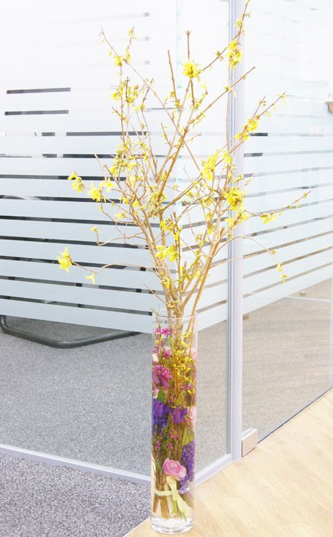 Bright, creative floral design for a business or venue reception area. Submerged spring flowers and blossom. Florissimo, Shropshire