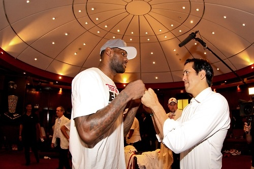 Head Coach Erik Spoelstra of the Miami Heat celebrates with LeBron James in the locker room following their team's series victory against the Indiana Pacers