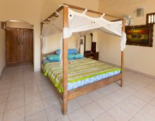 Wide double beds with mosquito netting  www.binginbungalows.com