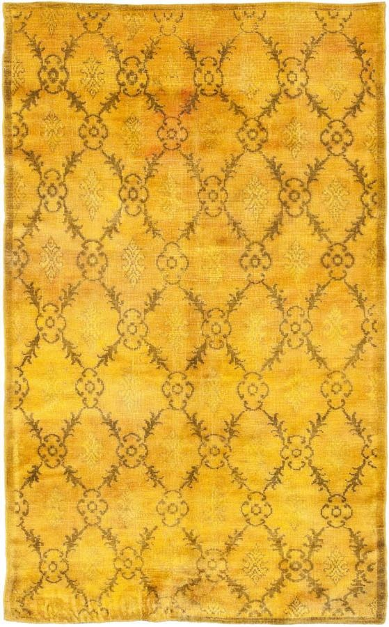 wool rug handwoven in Turkey, neutralized from its original color retaining the essence of its design and then over-dyed to create a remarkable chromatic state. From The Color Reform Collection by ABC Carpet - yellow