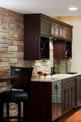 Doing a basement remodel? Check out this great kitchenette for small spaces! What a great way to showcase your favorite wines in these built in wine racks. We love that there is a small sink and faucet-perfect for mixing that perfect cocktail during your football parties! #home #decor