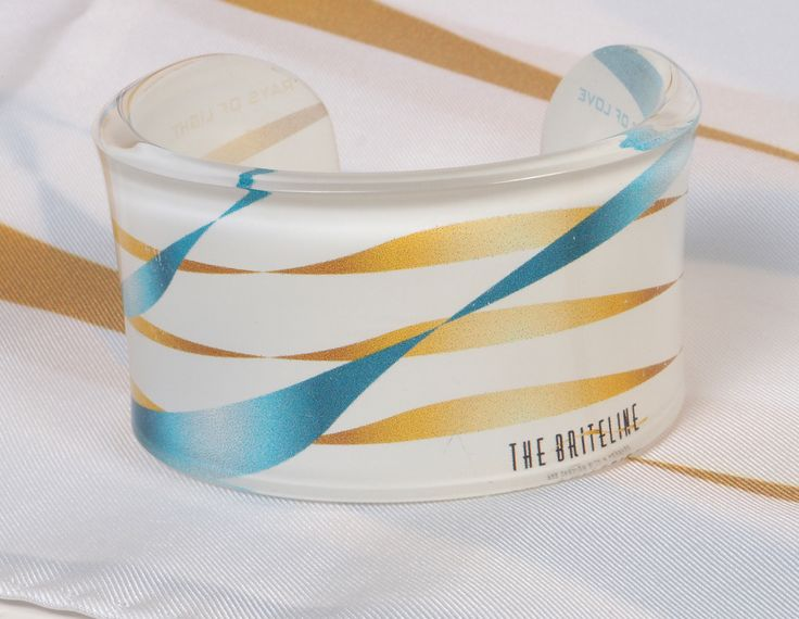 "THE BRITELINE Foulard and Bracelet - Label Series ""RAYS OF LIGHT - WAVES OF LOVE"" Created for FASHION for LIFE. Sales support the cause of the Palliative Care Unit 'Jenny Karezi ' of the School of Medicine, University of Athens"
