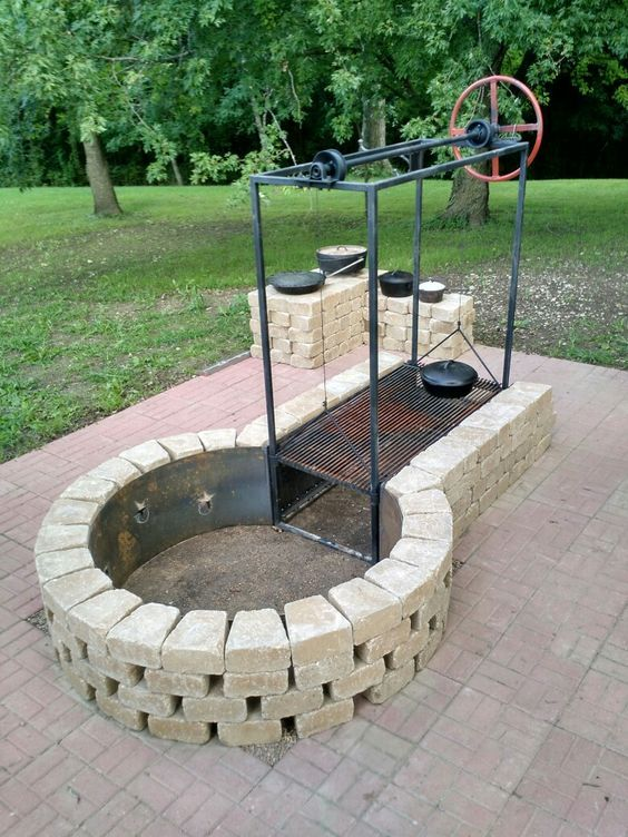 Keyhole Fire Pit With Adjustable Grille. Build Fire In Circle, Push Coals  Into Rectangle To Grill.