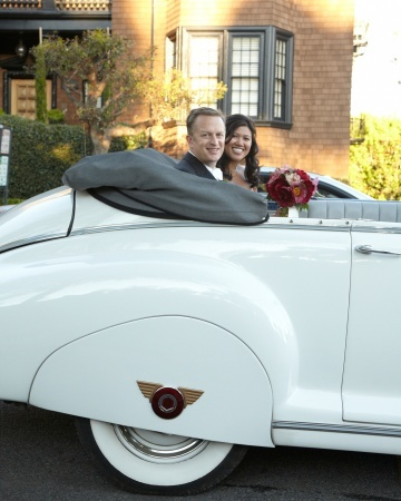 After the church ceremony, the newlyweds hopped into a 1949 Packard convertible.