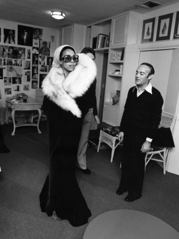 (super duper fly...) During photo sessions, noted designers Ray Aghayan and Bob Mackie make adjustments on the cape and dress which Diahann Carroll chose for the Academy Awards. By Isaac Sutton