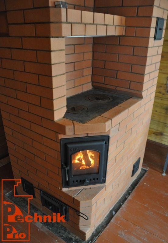 Отопительно варочная печь с двухконфорочной плитой