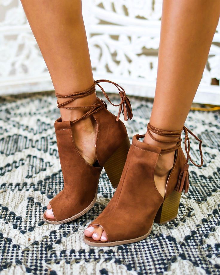 WWW.VICICOLLECTION.COM In love with our chic Ko Samui Bootie! Perfect for any outfit! A faux suede peep toe bootie with a stacked heel and delicate tassle fringe ties. A cushioned insole and non-skid rubber sole.