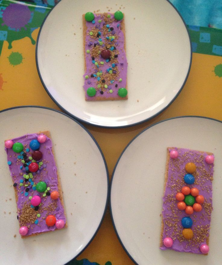 Jasmine's Magic Carpets - graham crackers covered in frosting and decorated with candy and sprinkles - Aladdin Movie Night - Disney Movie Night - Family Movie Night
