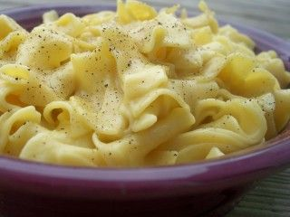 I found this recipe on another website (dont remember which one).  They are really easy and very good.  Much better than a buttered noodle, although there is a lot of sodium.  I use low sodium chicken broth.