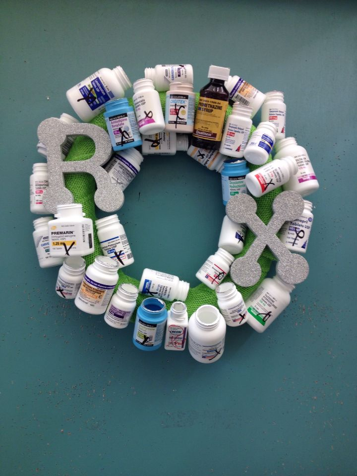 Pharmacy wreath. Notice all the x's on the bottles? Love it!! LOL!!