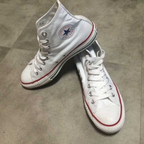 White high top Chuck Taylor's Only worn a few times, some scuffs on front of shoe, mud/bleach stain on outside of left shoe, price negotiable because of stain! Converse Shoes Sneakers