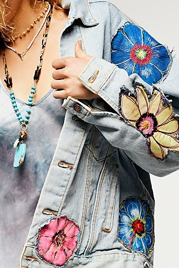 In a slouchy oversized fit, this denim jacket is made from vintage denim, featuring American hand painting and embroidery detailing | Specialty Floral Denim Jacket | Bohemian Fashion | Boho Denim Jacket
